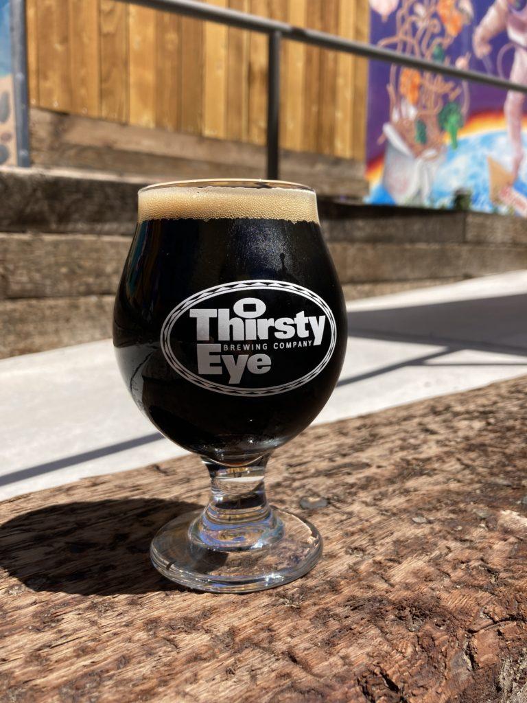 dark beer in a goblet glass